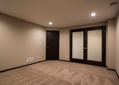 Basement Remodel with Custom Barn Door – Verona, WI