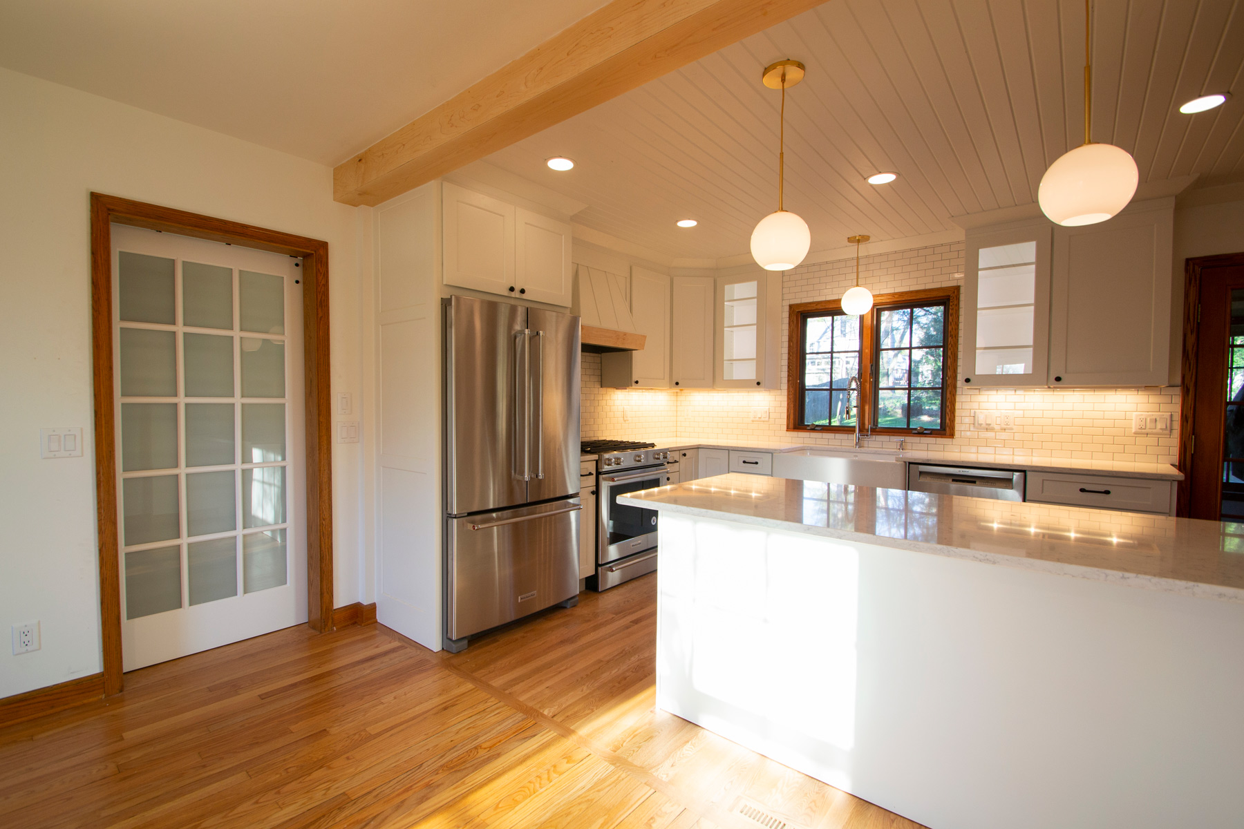 Kitchen and view of sliding barn door in dining room